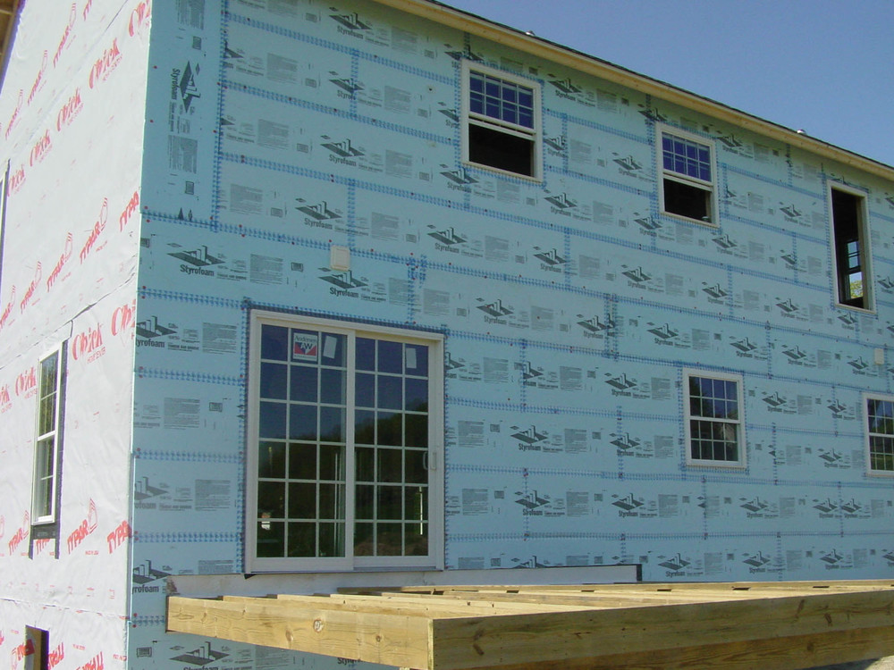 Rigid foam: Sheets of foam applied to the exterior of your home and taped seams help prevent thermal bridging.