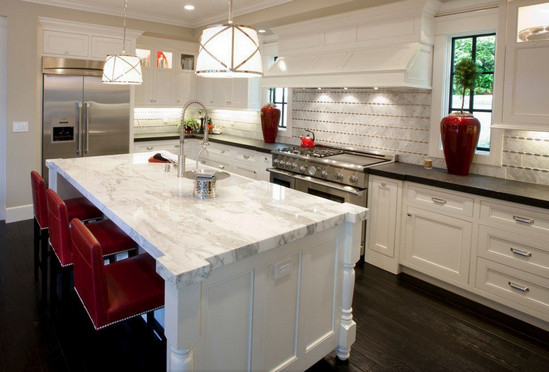 A Carrara marble countertop on this island provides a nice contrast to the darker countertops in the rest of the kitchen. Carrara marble is a current favorite amongst designers.