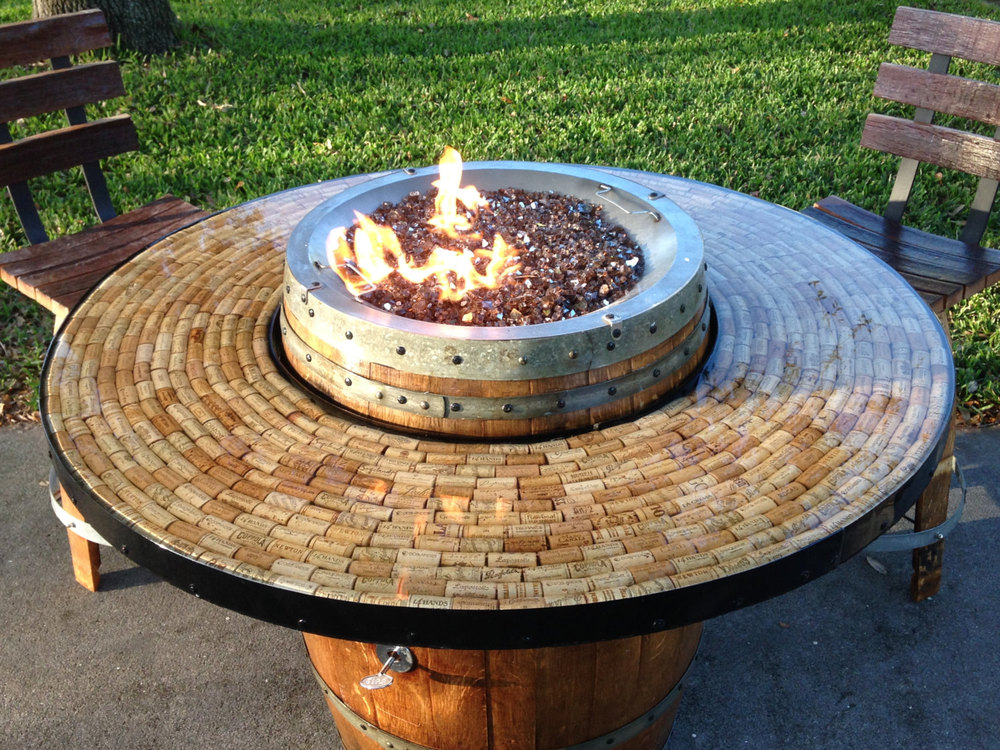 Vin de Flame Vin de Flame wine barrel fire pit tables bring the flavor of the vineyards into outdoor living spaces.  Each fire pit is unique and tells its own story.