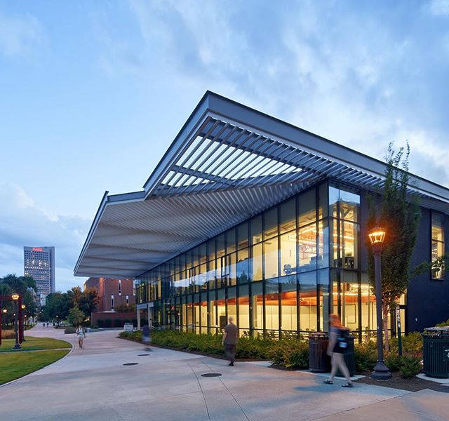 Caddell Building - School of Building Construction, 2015. We stripped down this diminutive concrete structure - a former truck depot from the 1950's - and gave it transparency, reach, resiliency, and presence in the larger campus, with a 28' cantilevered solar canopy, shading all sides of the building. It's LEED Platinum, has daylighting and views in 98% of spaces, and costs $1/SF per year for all energy loads. Thanks to all the leadership @georgiatech @gtarchitecture @bcatgatech who supported this transformative project, our efforts to create ambitious architecture for the public and in the public realm, and thanks to @brucedamonte for some excellent new photographs! . . . #sustainability #architecture #architecturephotography #leedplatinum #bldgs #atlanta #buildings #gatech