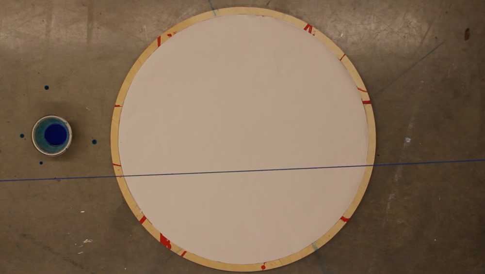 "String Theory (2013) 28"" Baltic Birch Disk, Newsprint, Acrylic.  Performance exploring mark making, psychogeography, memory, archive, and data visualization.       What is the size of a location? Where are you in relation to a place of trauma? How can participants negotiate shared embodied experience via a span?"