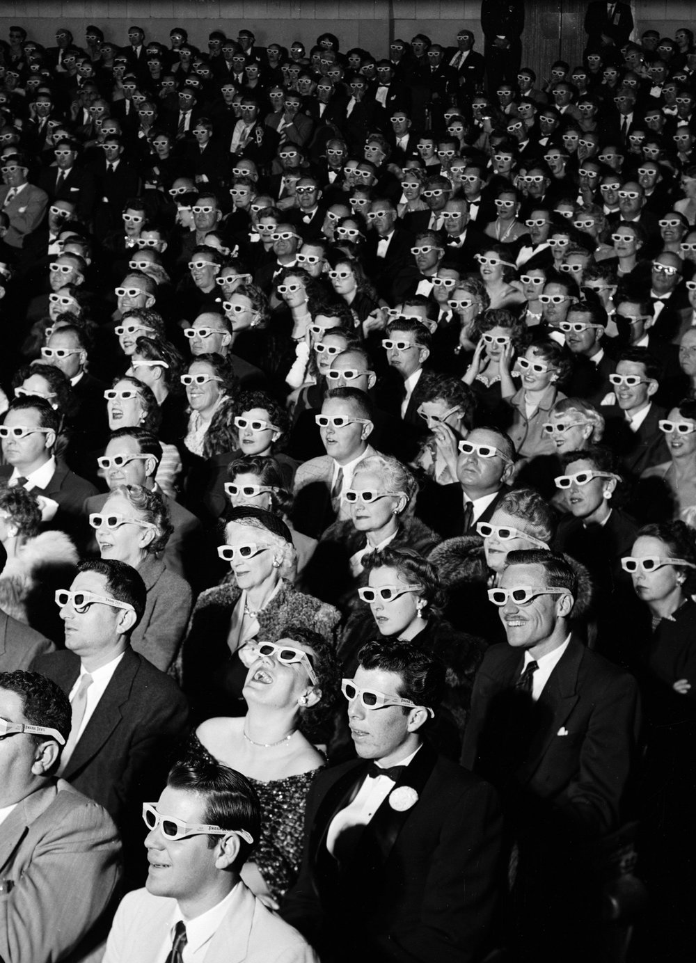 "J.R. Eyerman's iconic photo for Time Magazine. These moviegoers are at The World Premiere of ""Bwana Devil"". The ""first"" 3D film. The image was populaized in critical acadmeic circles on Guy deBord's book ""Society of the Spectacle"""