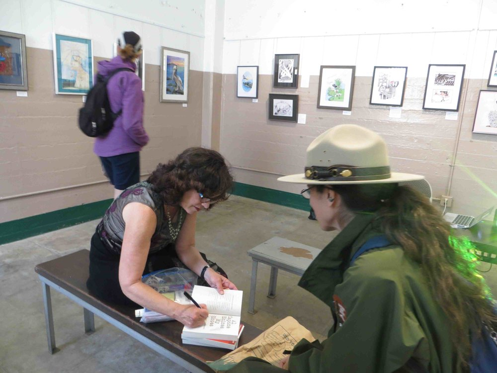 Gennifer Choldenko signing books for Ranger Kathryn.jpg