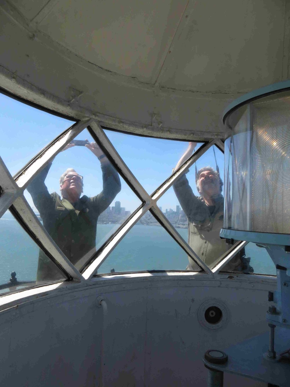 Ranger John and James taking pics of Paul on top of lighthouse