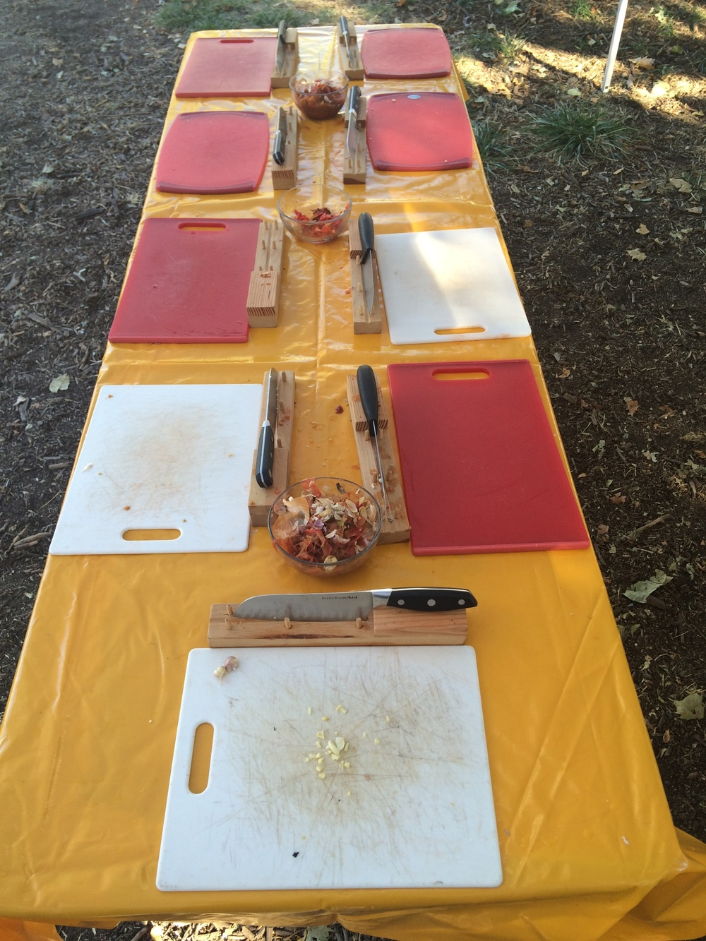 Students learn knife skills in the outdoor kitchen