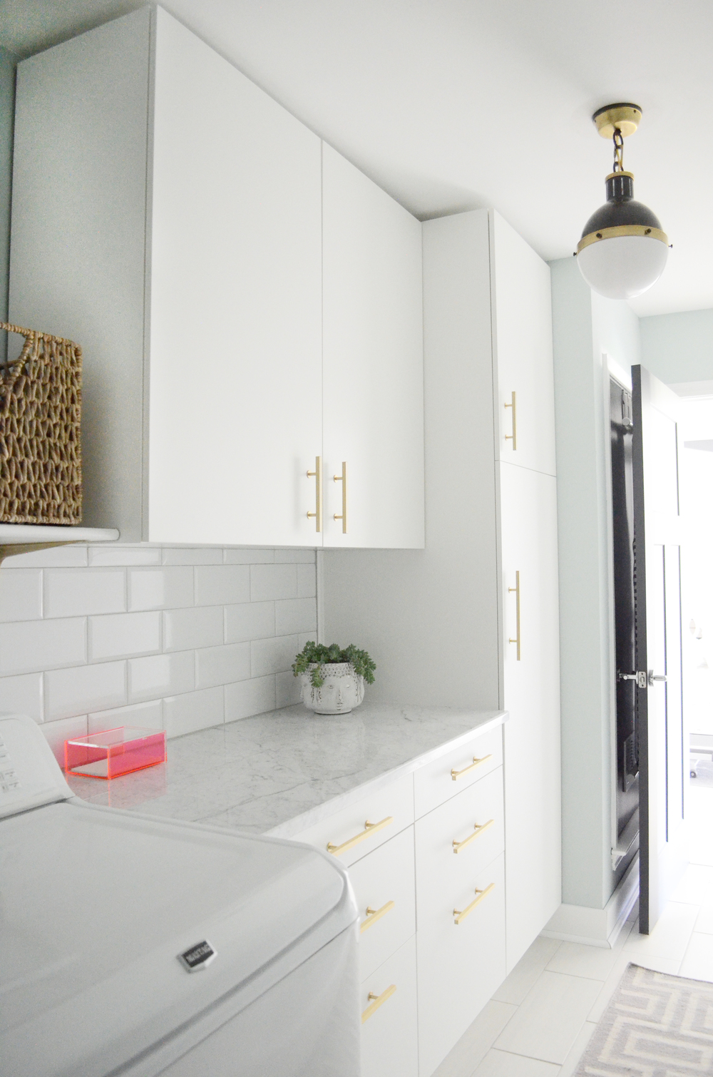 Carrara marble with beveled subway tile and Hick's pendant