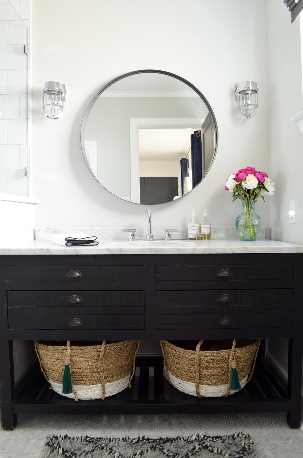 dark wood vanity with marble countertop.jpg