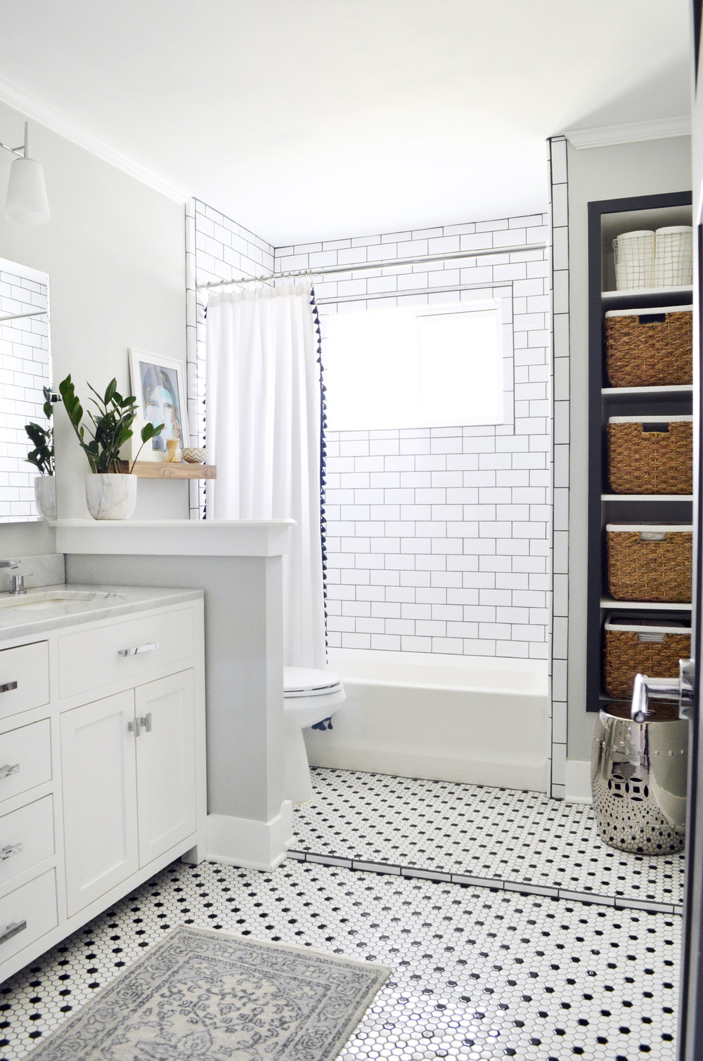 black and white hex tile shower with window.jpg