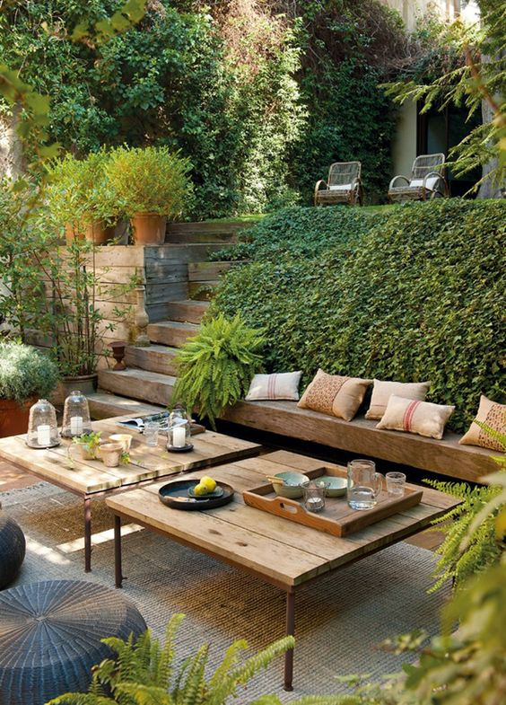 lush greenery makes this outdoor space feel private via myhabitfix.com