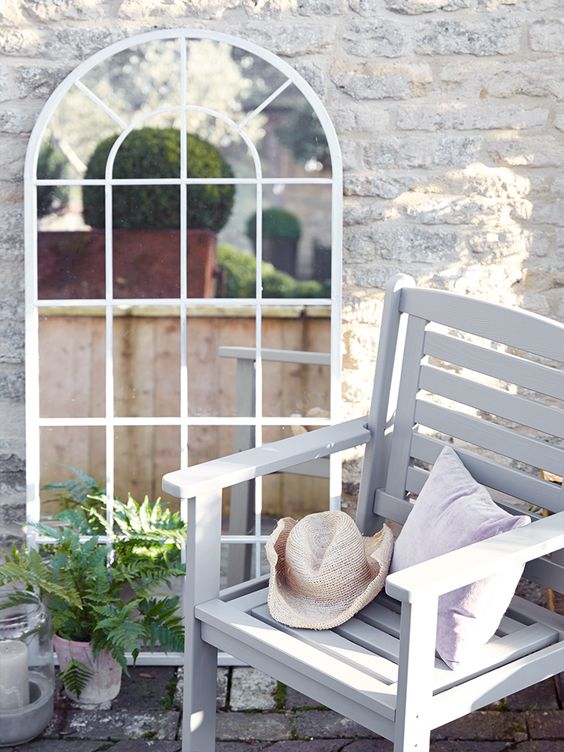 a mirror in an outdoor space adds elegance -image via coxandcox.co.uk