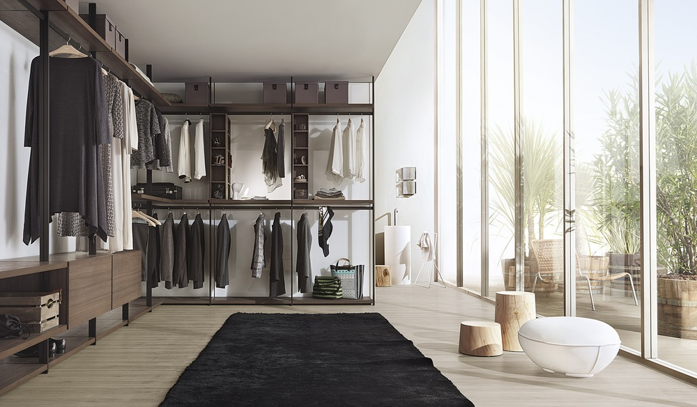 HANGAR BY LEMA   Completes the historical catalogue of Lema walk-in wardrobe. Designed by Piero Lissoni, adds to the cladding panels and glass illuminated wall wooden uprights using floor / ceiling that help support the weight of the equipment and provide a quality detail.