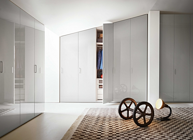 HINGED DOORS BY LEMA    Made to measure wardrobe is the modular system that offers maximum freedom of construction due to the wide range of modules available and the ability to cut according to the desired size, height, width, depth. It is available with hinged door - in 5 heights, 6 widths modules that can be combined with each other, with opportunities to choose between 18 types of doors and folding doors - or with sliding door - in 3 heights, 5 widths with the possibility of choosing from 8 different types of doors.