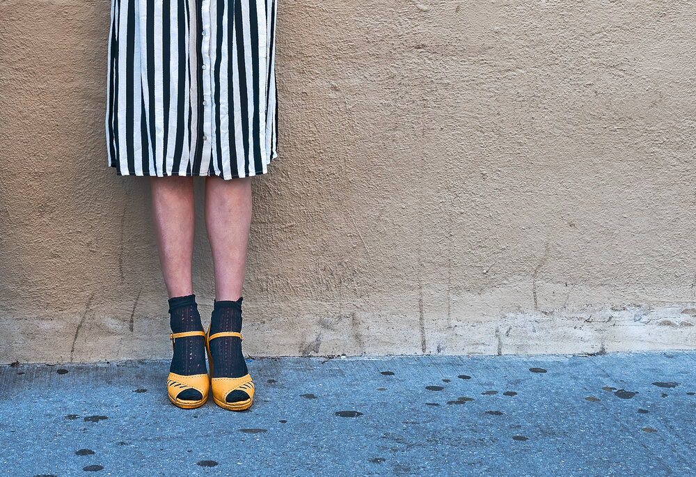 yellow shoes, black socks