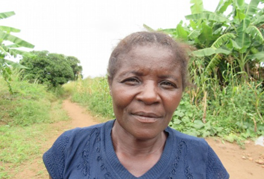 Alis Mpande, a 54-year-old resident who makes her living by farming, shares that she is happy since she can drink safe water from the well again.