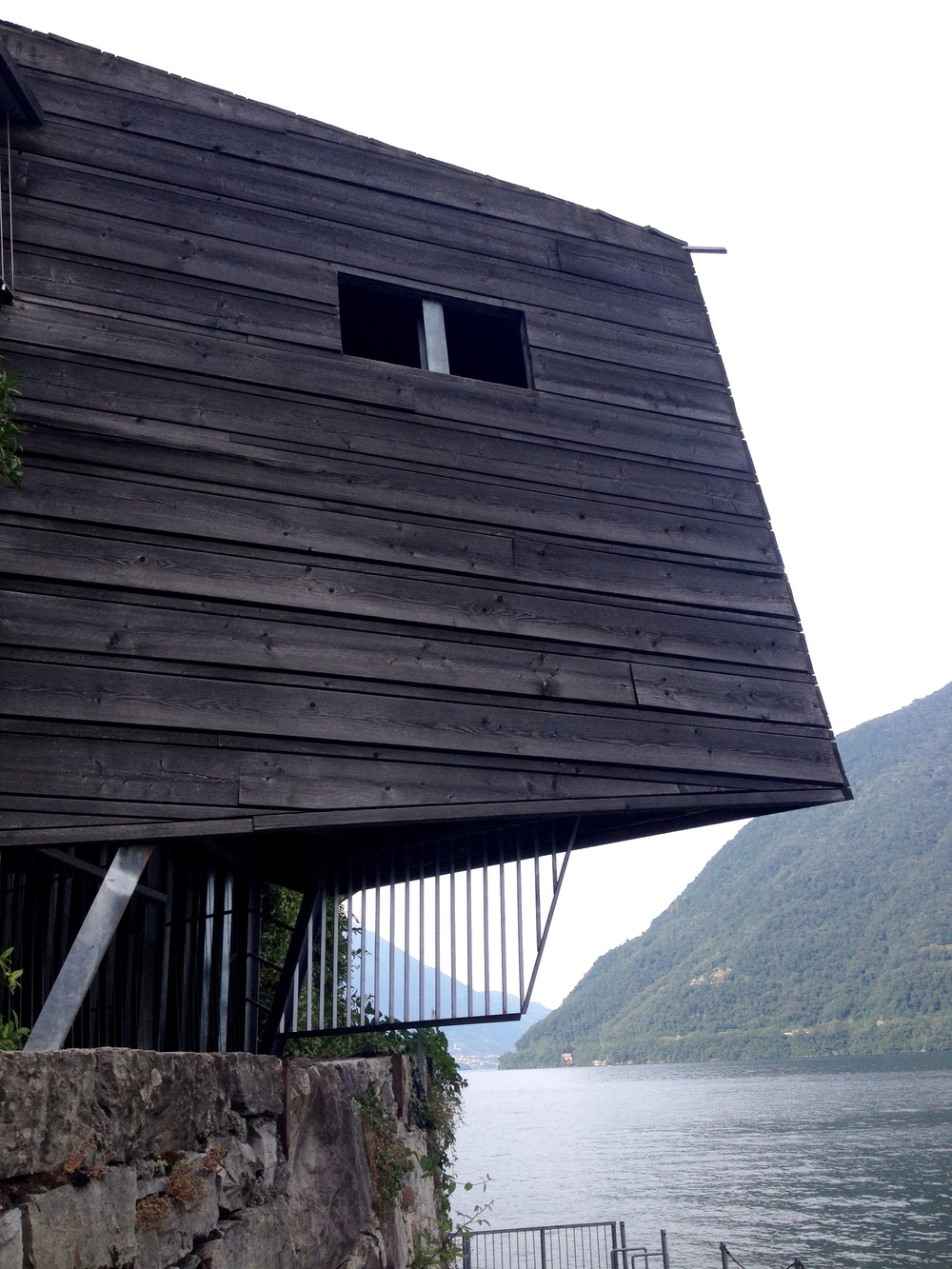 A custom built area for sunbathing, changing, and diving by the lake at Brienno, Italy.