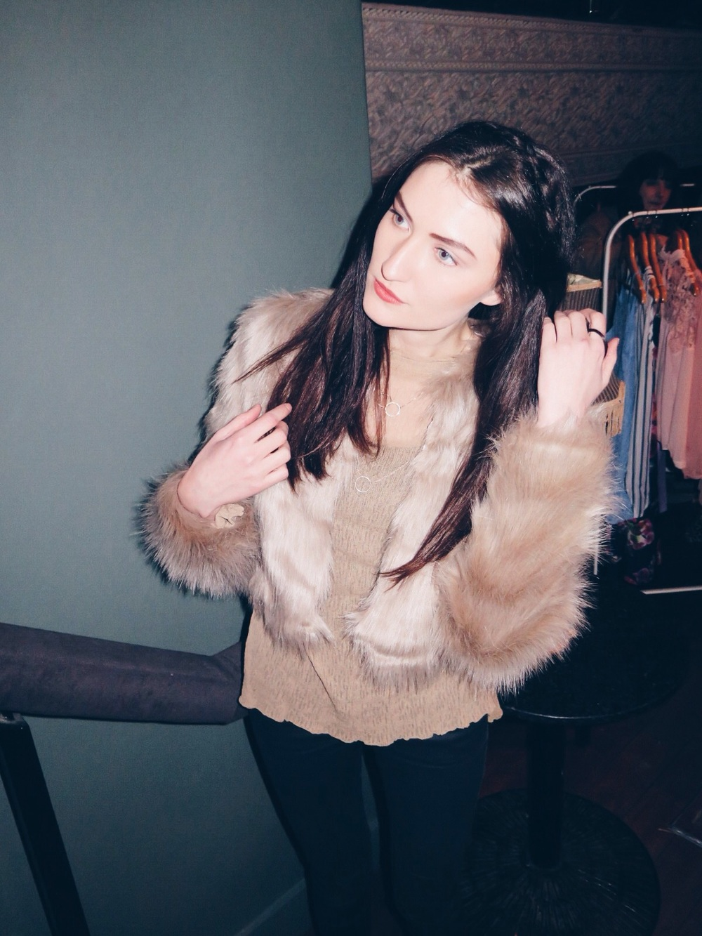 Jenny Drea trying on la faux fur jacket from the show