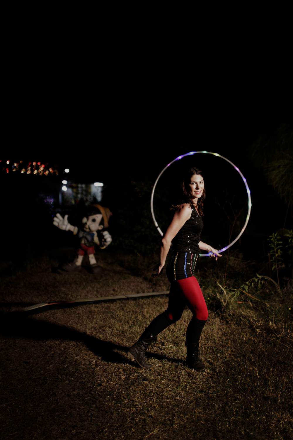 Hoola hooping with an abandoned Pinocchio looking on in amazement.