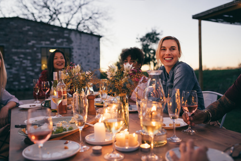 women at dinner together outdoors.jpg