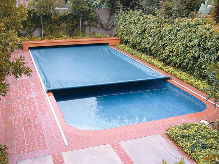 Now These Covers Arent All That Bad! They Run On A Tracks Beside Your Pool  So Are Very Easy To Remove And Put On. The Vinyl Does Keep Some Heat In The  ...