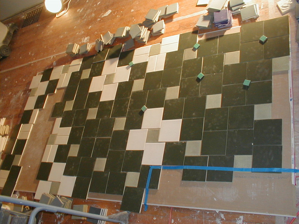 Since there was only so many of any one color tile (warehouse sale) the design needed to be laid out exactly before being installed