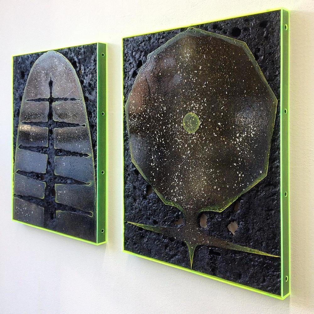 """Black shape #3"" (left) and ""#2"" (right), 2016, spray paint, pigment, burns, varnish, oil paint on wood, plexiglass 18x14 inches"