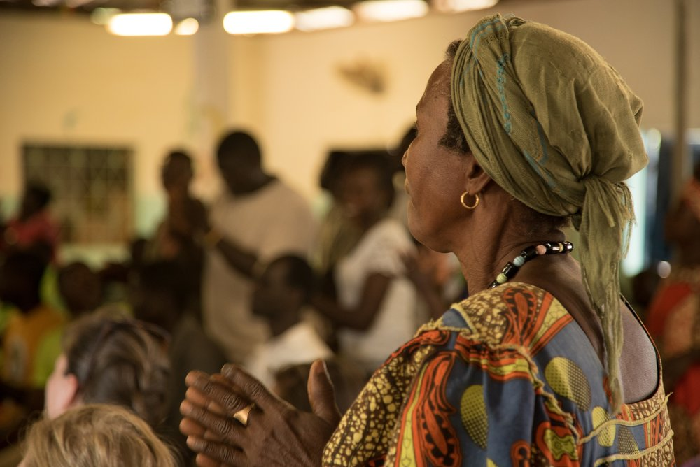Woman worshiping in Guinea-Bissau