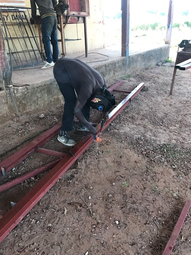 Nilton working on a truss for  a roof the welding students built .