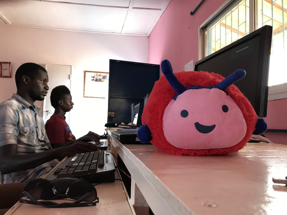 Gus visiting the computer class at West African Vocational Schools.