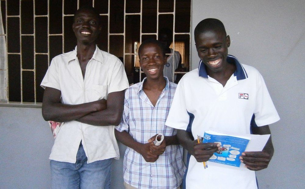 Vasco, center, while he was a computer student at the WAVS School. This photo was taken in April 2011.