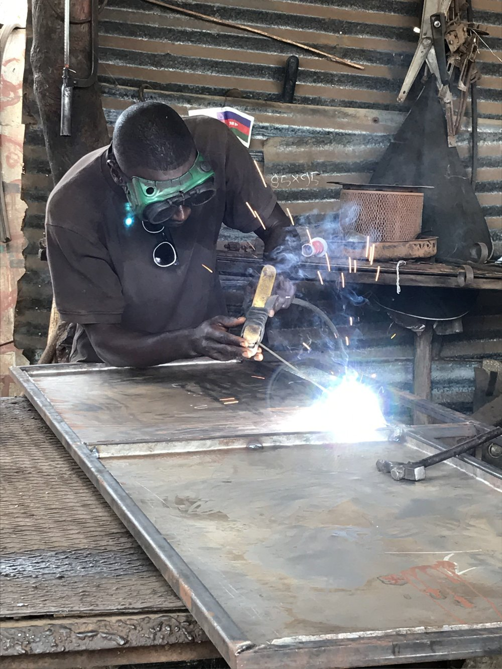 Welder working on a door