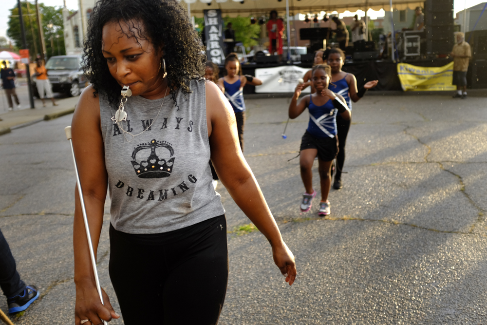 An dance and twirling instructor leads her class off stage after performing at a jazz festival in Petersburg in July 2015. Photograph by Scott P. Yates.
