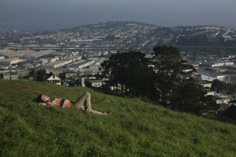 A man relaxes on a hillside over looking San Francisco on January 16, 2011. (Photograph by Scott P. Yates)