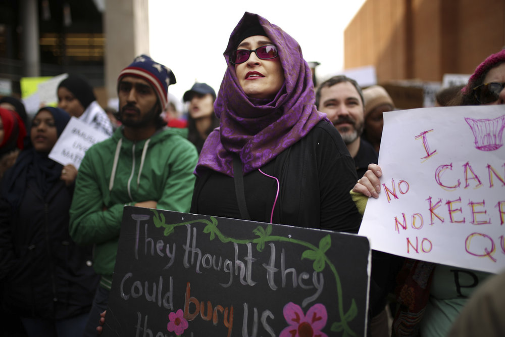 "Residents and students gathered for the ""Muslim Ban and Border Wall Protest"" on the campus of Virginia Commonwealth University in Richmond, Va., on Sunday, Jan. 29, 2017. [Scott P. Yates/progress-index.com]"