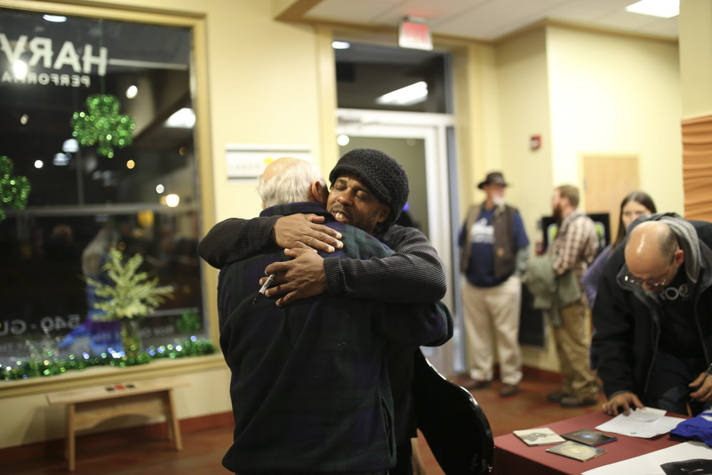 The internationally-renowned musician Victor Wooten, facing, hugs Dad Yates after a performance on March 3, 2017, at the Harvester Performance Center in Rocky Mount, Va. [Photograph by Scott P. Yates]
