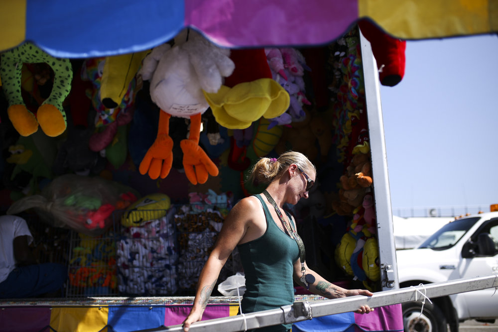Amy Tennant, a worker for Deb's Concessions, assembles a game booth during preparations for 2017 Dinwiddie County Fair at the Virginia Motorsports Park in North Dinwiddie on Tuesday, September 5, 2017. The fair is scheduled to open on Friday night and remain open until Sunday night. [Scott P. Yates/progress-index.com]