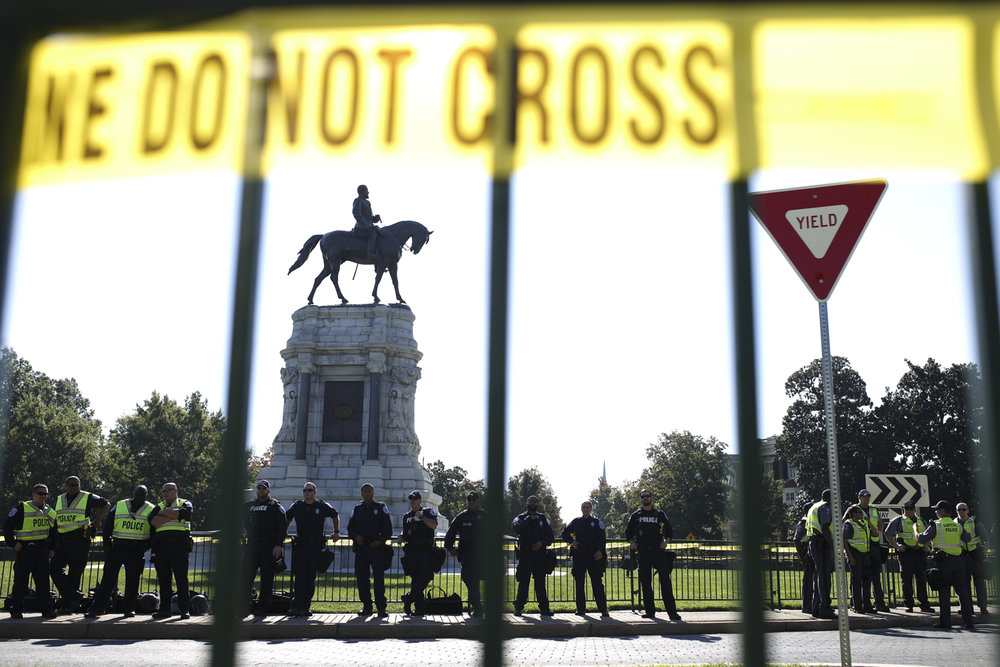 A massive law enforcement presence appeared during rally - and its counter protest - to support the Confederate statues on Monument Avenue in Richmond on Saturday, Sept. 16, 2017. [Scott P. Yates/progress-index.com]