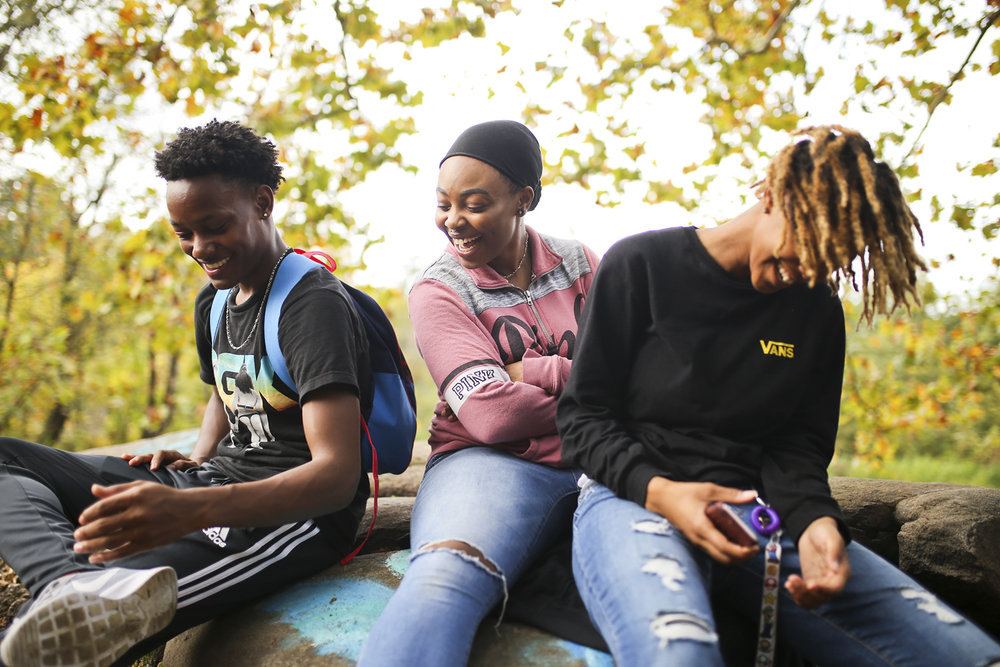 Virginia State University first-year students, from left, Xavier Parker, Nevada Peterson and Sam Cooke, sit on a rock on the bank of the Appomattox River near the old Merchant's Mill Dam on the Appomattox River Heritage Trail in Petersburg on Monday, Oct. 9, 2017. [Scott P. Yates/progress-index.com]