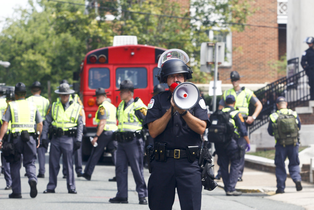 Charlottesville police and Virginia State Police declare an unlawful gathering after rallies and counter protests turned violent in Charlottesville, Va., on Saturday, August 12, 2017. [Scott P. Yates/progress-index.com]
