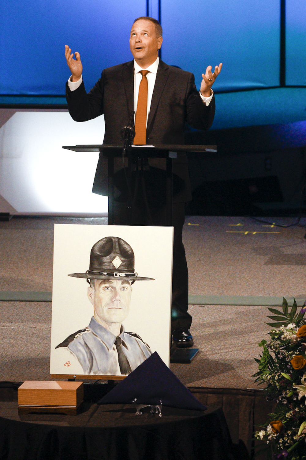Will Payne, a long-time friend of fallen Virginia State Police Lt. H. Jay Cullen, gestures upwards as he talks about what he thinks Cullen may have thought about all the attention paid to him, during a memorial service at Southside Church of the Nazarene in Chesterfield on Saturday, August 19, 2017. [Scott P. Yates/progress-index.com]