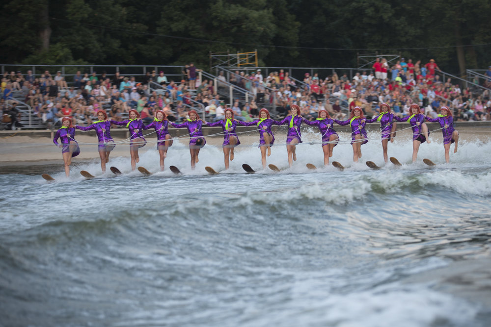 "Team members portraying the ""Daphne"" character, perform the water ski portion of the ballet line as the audience watches from the grandstands. One of the team's long-term plans is to expand the grandstands so more people may attend the shows. [SCOTT P. YATES/RRSTAR.COM STAFF]"
