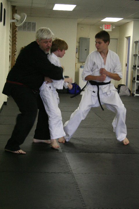 Shihan Jakle tests students during a black belt ranking.