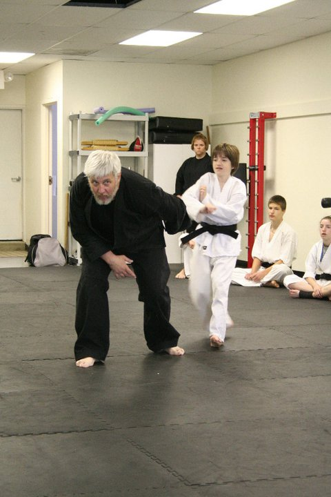 Shihan Jakle demonstrates techniques.