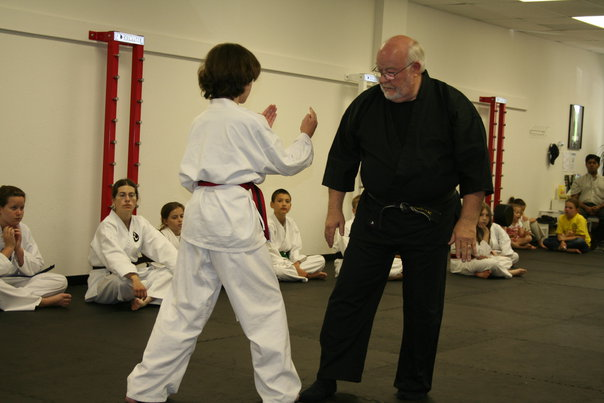 Soke Byers testing a student during a black belt test.