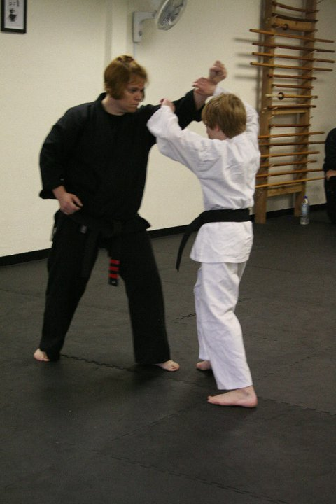 Sensei Kelli (Ballard) tests the black belt student.