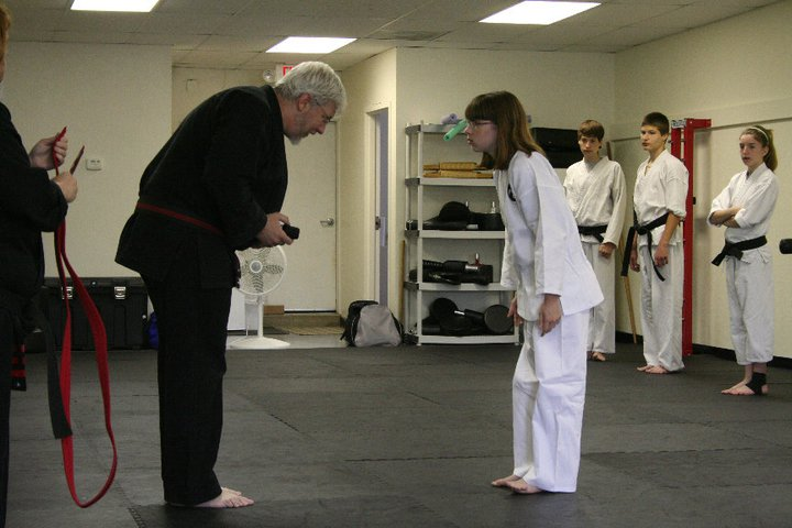 Shihan Keith Jakle awards a black belt.