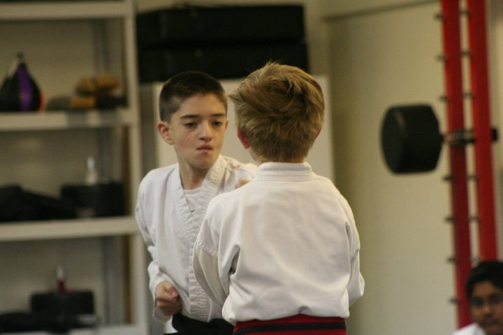 Young black belts sparring / testing.