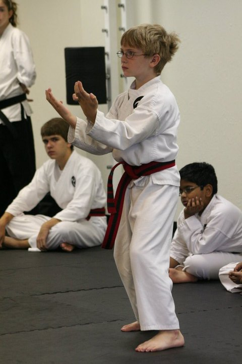 The prospective black belt designee... before ...