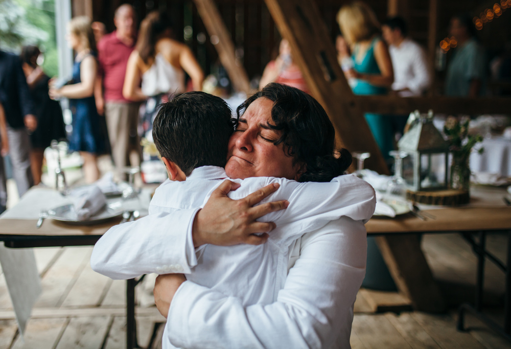 I usually cry at weddings, get misty during toasts, a little sappy when I see a new couple staring at each other. But it's not so often that during a simple embrace that so much can be read on a bride's face. I actually sobbed and lowered my camera.