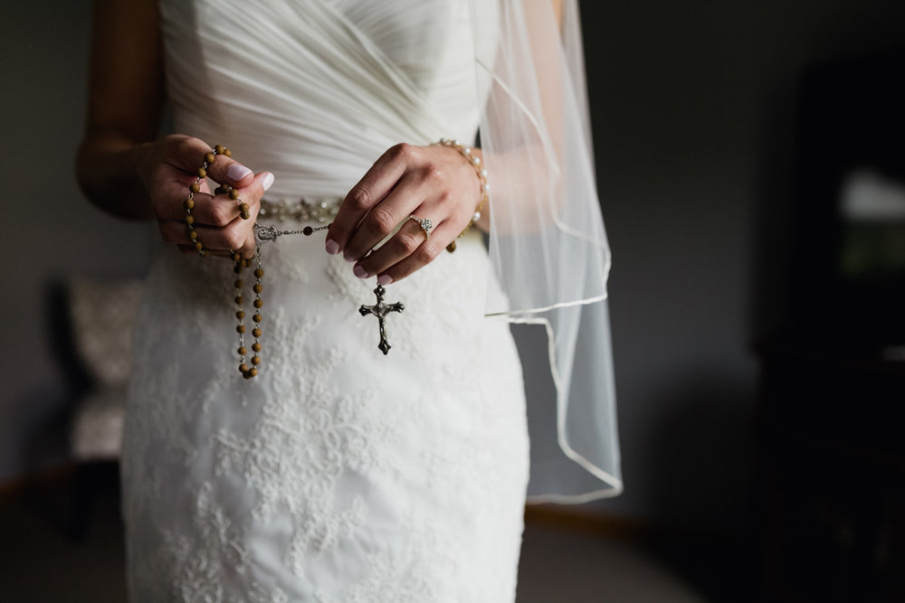 Bride with rosary. Catholic bride on her wedding day.