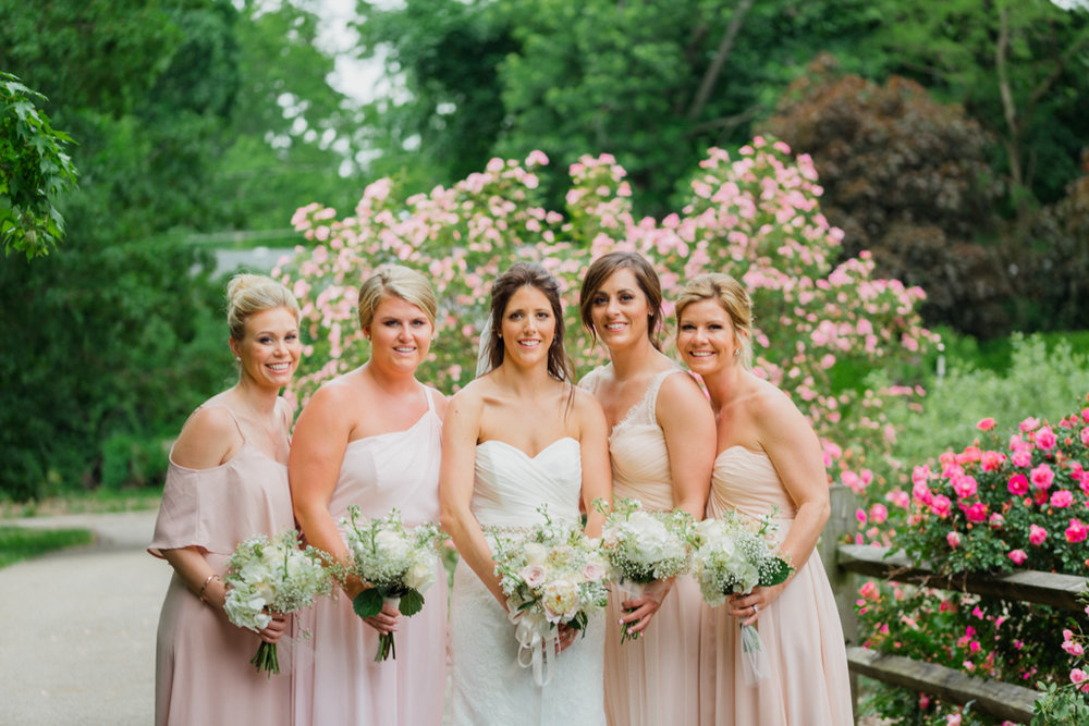 Bride and Bridesmaids at Park of Roses wedding. Bridal party at the Park of Roses, Columbus OH.